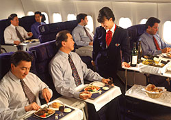 Dining in first class (Photo: Stewart Cohen/Index Open)