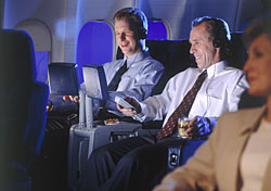 First-class travelers watching videos (Photo: Stewart Cohen/Index Open)