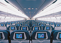 Coach-class seats with individual video screens on Northwest's A330 aircraft (Photo: Northwest)