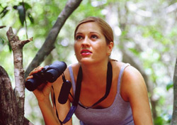 Woman viewing wildlife in Belize with binoculars (Photo: IndexOpen)