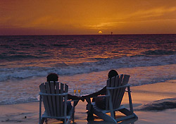 Couple on beach at sunset (Photo: Bermuda Department of Tourism)