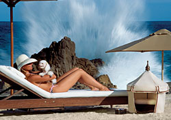 Woman sunbathing with puppy (Photo: One&;ampOnly Resorts)