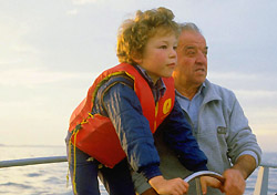Grandfather teaching grandson how to sail (Photo: IndexOpen)