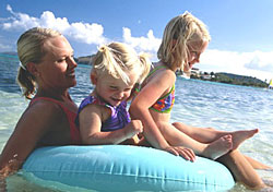 Mother and kids at the beach (Photo: PhotoDisc)