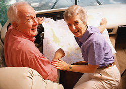 Senior couple reading a map (Photo: Getty Images)