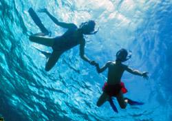 Children snorkeling  (Photo: Tammy Peluso/iStockphoto)
