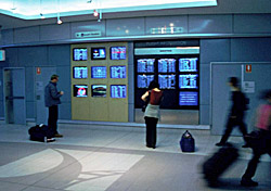 People looking at airport monitors (Photo: Index Open)