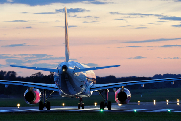Rear of Airplane Landing at Sunset (Photo: Thinkstock/iStock)