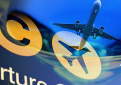 Air: Airplane Reflection on Airport Sign (Photo: Thinkstock/Hemera)