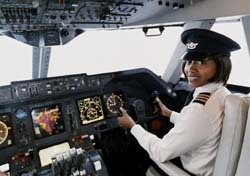Female Pilot Smiling at Camera (Photo: Thinkstock/Photodisc)