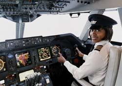 Female Pilot Smiling at Camera (Photo: Thinkstock/Photodisc)