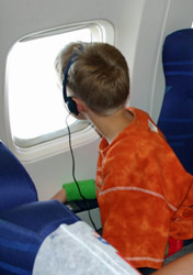 Boy looking out airplane window (Photo: iStockphoto/Gertjan Hooijer)