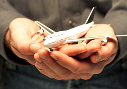 Air: Man Holding Plane in Hands (Photo: Thinkstock/Hemera Technologies)