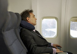 Air: Man Sitting with Neck Pillow (Photo: Thinkstock/Jupiterimages)