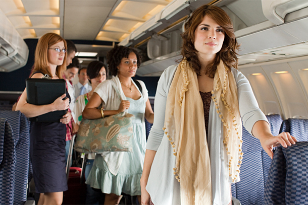 Passengers Standing in Airplane Cabin During Boarding (Photo: Getty Images/Digital Vision)