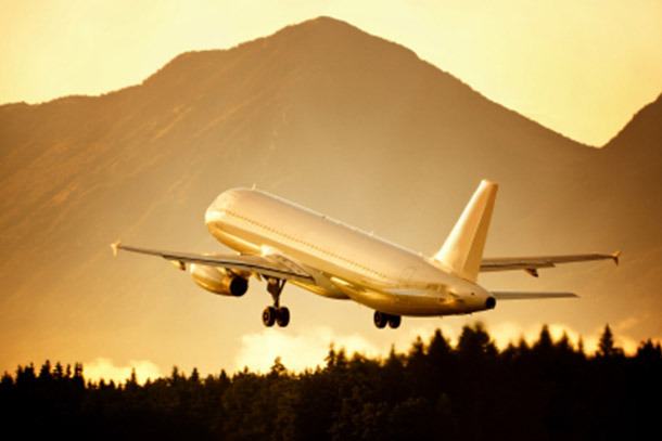 Air: Airplane Taking off With Mountains and Sunrise (Photo: iStockphoto/Tomas Bercic)