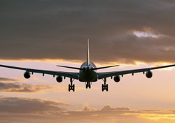 Air: Rear of Plane Flying Into Sunset (Photo: Shutterstock/Josef Hanus)