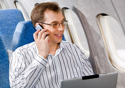 Air: Man Sitting in Plane, on Phone (Photo: Thinkstock/Hemera)