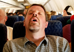 Sleeping on an airplane (Photo: iStockPhoto/Stephanie Horrocks)