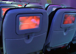 "<H2>The View From Coach</h2>  This is the view most people will have aboard a Virgin flight, and it's not a bad one. The seats are comfortable and roomy, despite an unspectacular <a href=""http://www.seatguru.com/airlines/Virgin_America/Virgin_America_Airbus_A319.php"" target=""_blank"">32 inches of legroom</a> (12 Cabin Select seats have 35 inches). The seats are designed to be lower to the ground, which pulls your knees away from the seat in front of you. The onboard entertainment system is robust and fun to use, ordering meals from your seat is convenient, and the mood lighting (if that's your thing) lends a unique and soothing atmosphere to the stylish cabin.   Still, I couldn't help but think that all these bells and whistles were merely distractions from the fact that hardly anything onboard is complimentary. Meals, snacks, and drinks cost between $3 and $10, movies are a hefty $8, and in-flight Wi-Fi sets you back $9.95 for flights under three hours and $12.95 for longer trips. Of course, how much you want to purchase is up to you, and the cabin <i>is</i> really cool.  (Photo: SeatGuru/Erin Liszewski)"