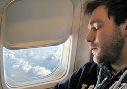 Air: Man sleeping on plane (Photo: iStockphoto/Agnes Csondor)