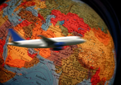 Airplane Flying Around Globe (Photo: iStockphoto/kickers)
