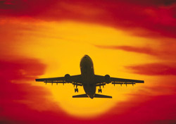 Airplane Silhouette Against Red Sunset (Photo: Thinkstock/Digital Vision)