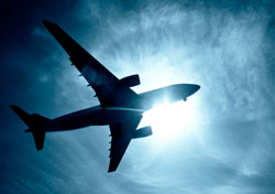 Airplane Silhouette Blue Sky (Photo: iStockphoto/