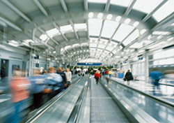Airport: Blurred Travelers on Moving Walkway (Photo: Thinkstock/Digital Vision)