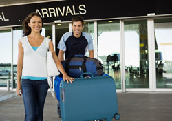 Airport: Couple Leaving Airport with Luggage (Photo: Thinkstock/Jupiterimages)