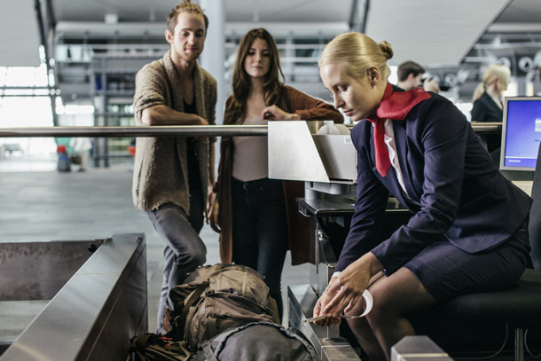 Airport: Couple Looks On As Bags Are Checked (Photo: Hinterhaus Productions/Getty Images)