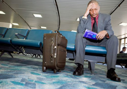 Airport: Man - Sitting, Waiting (Photo: Thinkstock/Creatas)