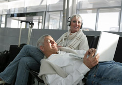 Airport: Mature Couple on Electronics (Photo: Thinkstock/Eyecandy Images)