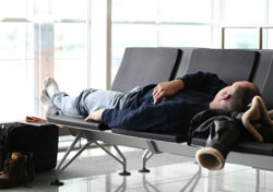 Man sleeping in an airport (Photo: iStockphoto)