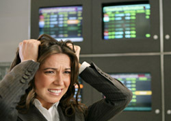 Airport: Woman Stressed at Airport, Flight Screens (Photo: Thinkstock/Eyecandy Images)