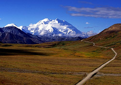 Visitors come to Denali National Park, the crown jewel of Alaska's national parks, to witness Mt. McKinley, the highest peak in North America at 20,320 feet. Getting to Alaska can be expensive, but you can save on Denali and Alaska travel with the Great Alaskan TourSaver coupon book. The book costs $100, but it can help you save much more with coupons that entitle you to two-for-one deals and other discounts on travel. For example, you can get two-for-one tickets for the Mt. McKinley flight-seeing tours and Anchorage-to-Denali rail packages.   (Photo: iStockphoto)