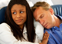 Airfare: Man sleeping on Woman's Shoulder (Photo: iStockphoto/Sean Locke)