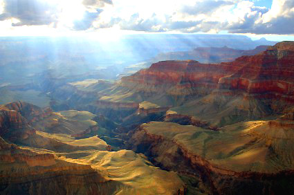 Grand Canyon, AZ - Sunlight peeking through the clouds over canyon