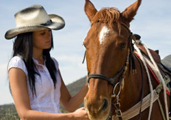Arizona - Woman with horse (Photo: iStockphoto/Judi Ashlock)