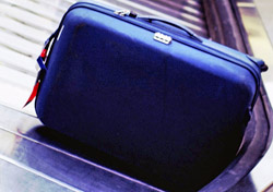 Close up of bag on airport carousel (Photo: Index Open)