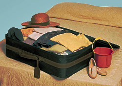 Suitcase on bed (Photo: Index Open)