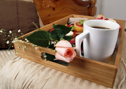 Breakfast in bed with a pink rose (iStockphoto.com/Stephanie Horrocks)