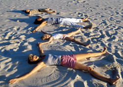 Beach: Family Making Sand Angels (Photo: Thinkstock/Pixland)
