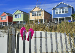 Beach: Pink Sandals, Row of Beach Houses (Photo: Shutterstock/Stacie Stauff Smith Photography)