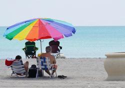 Beach: Rainbow Umbrella (Photo: Thinkstock/iStockphoto)