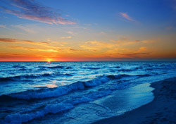 Beach with Blue and Orange Sunset (Photo: iStokcphoto/konradlew)