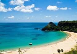 "<h2>Fernando de Noronha, Brazil</h2>  While most Americans have never heard of it, <a href=""http://www.noronha.pe.gov.br/eng/ctudo-tourism.asp"" target=""_blank"">Fernando de Noronha</a> is regarded by many Brazilians as having the most beautiful beaches in the country—and that's saying a lot coming from a nation full of sand and sun connoisseurs. With its steep bunny-ear hills that soar up from undeveloped white and gold beaches, Fernando de Noronha might look more at home alongside Bora Bora and the other islands of French Polynesia than it does hundreds of miles from mainland Brazil. But unlike those Pacific islands, Fernando de Noronha is cheaper and easier to get to, at least from the East Coast.   At only seven square miles, the island is easily explored by dune buggy. Pack some snorkel gear and head to beaches like Baia do Sancho and Baia dos Porcos, where you'll see sting rays, sea turtles, and a wide variety of colorful fish just feet from the shore. Without a doubt, the water surrounding the island— a national marine park—is Fernando de Noronha's top attraction. Besides snorkeling, you can experience Brazil's best scuba diving with <a href=""http://www.atlantisdivers.com.br/english/default.asp"" target=""_blank"">Atlantis Divers</a> (from about $75 for two dives) and go boating (about $25) to spot spinner dolphins and see the island's unusual rock formations up close.   In the evenings, head to Vila dos Remedios, the island's historic heart, where you'll dance the night away to traditional Brazilian music and eat seafood al fresco at the popular and cheap Bar do Cachorro. For affordable accommodations, stay at the simple but comfortable <a href=""http://www.pousadaparaisodoatlantico.com.br/i_index.htm"" target=""_blank"">Pousada Paraiso do Atlantico</a>, where prices for double rooms start around $78 a night.  (Photo: iStockPhoto/Mihir Panchal)"