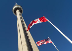 Flags in front of Toronto's CN Tower (Photo: Index Open)
