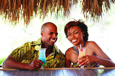 Couple drinking cocktails in the Caribbean