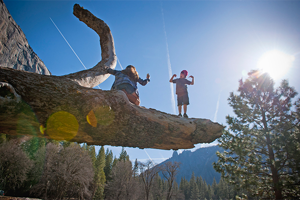 Children Playing on a Fallen Tree Branch, Yosemite National Park, CA (Photo: Getty Images/Stone)